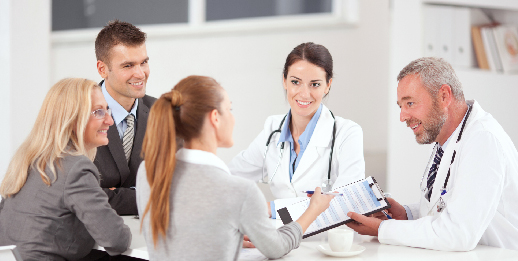 stock image of business people with doctors having a meeting